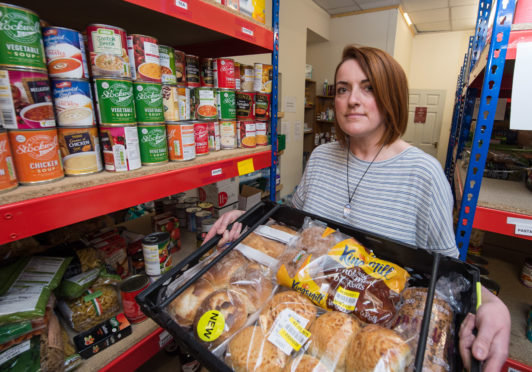 Volunteer Development Officer Gillian Pirie in the stores at Moray Foodbank.