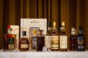 The final submissions for Craigellachie Village Council's annual whisky auction are being handed in.