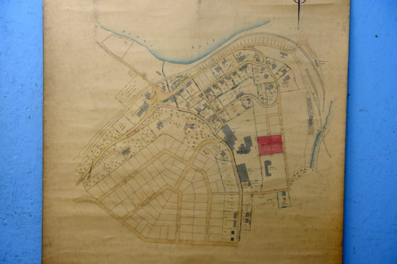 Dave Smith from Bervie Auctions, Inverbervie, is auctioning off an old planning map of Craigellachie.