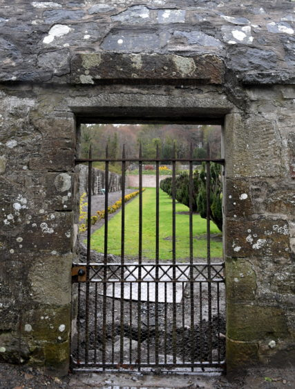 The gate in the wall dated 1715.
