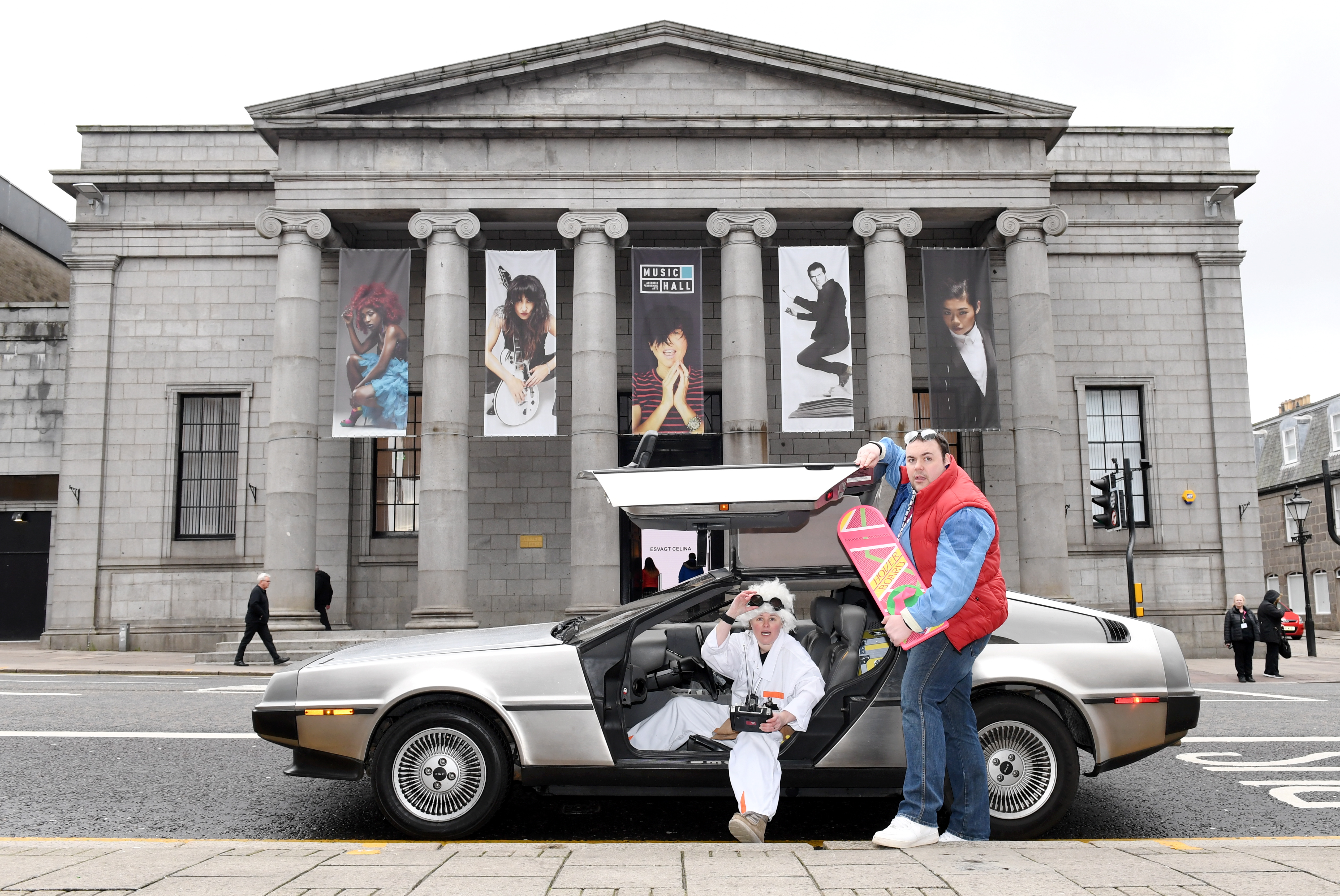 "To promote the upcoming showing of the movie ""Back to the Future"" accompanied by a live orchestra at the Music Hall, Aberdeen. Marty McFly (Graham Watt) and Doc Brown (Donna Henderson) came to town with their DeLorean.          Picture by Kami Thomson    04/04/2019"