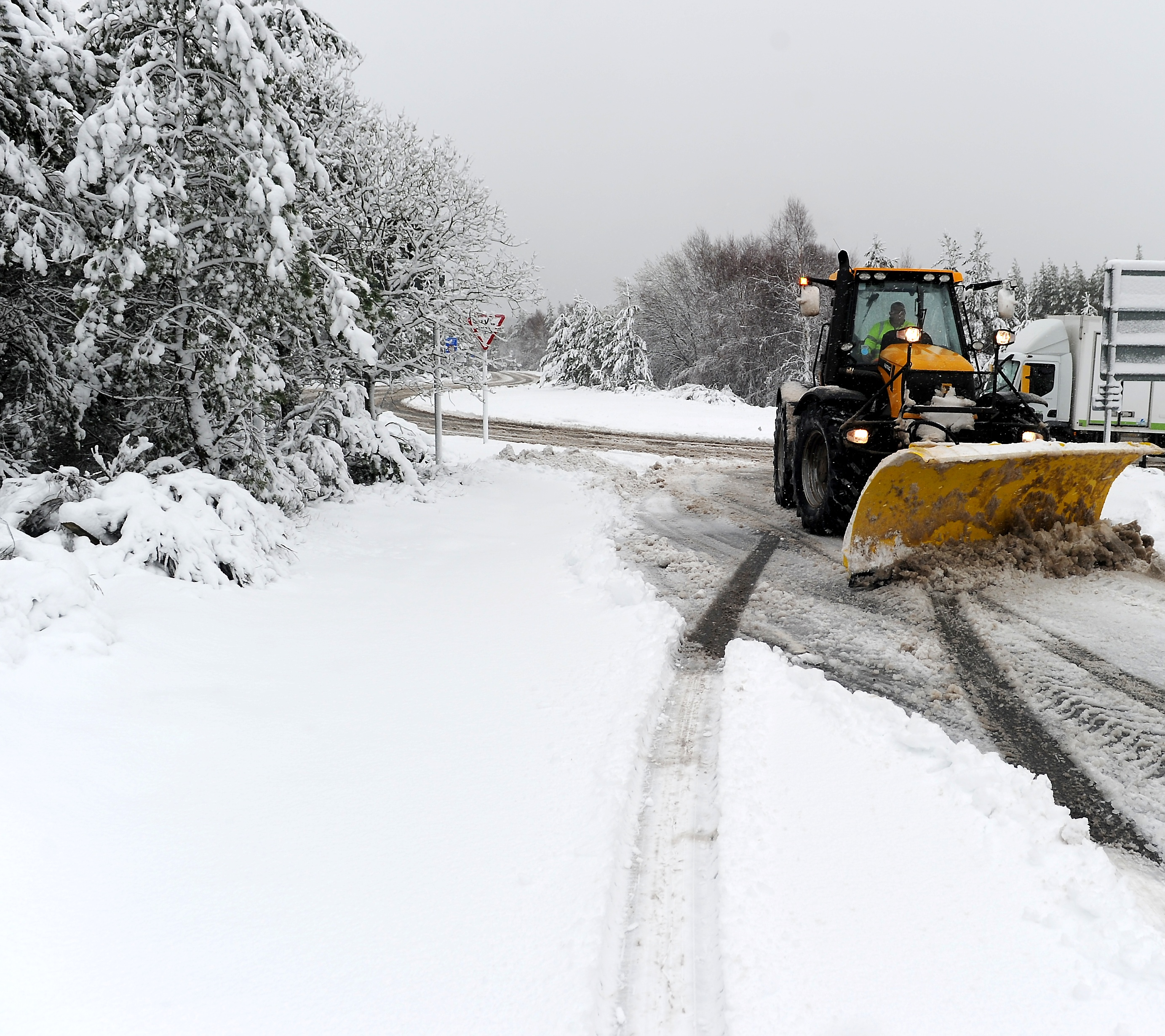 Heavy snow and traffic lights at Slochd made driving conditions difficult on the A9 between Carrbridge and Moy yesterday morning. Picture by Sandy McCook