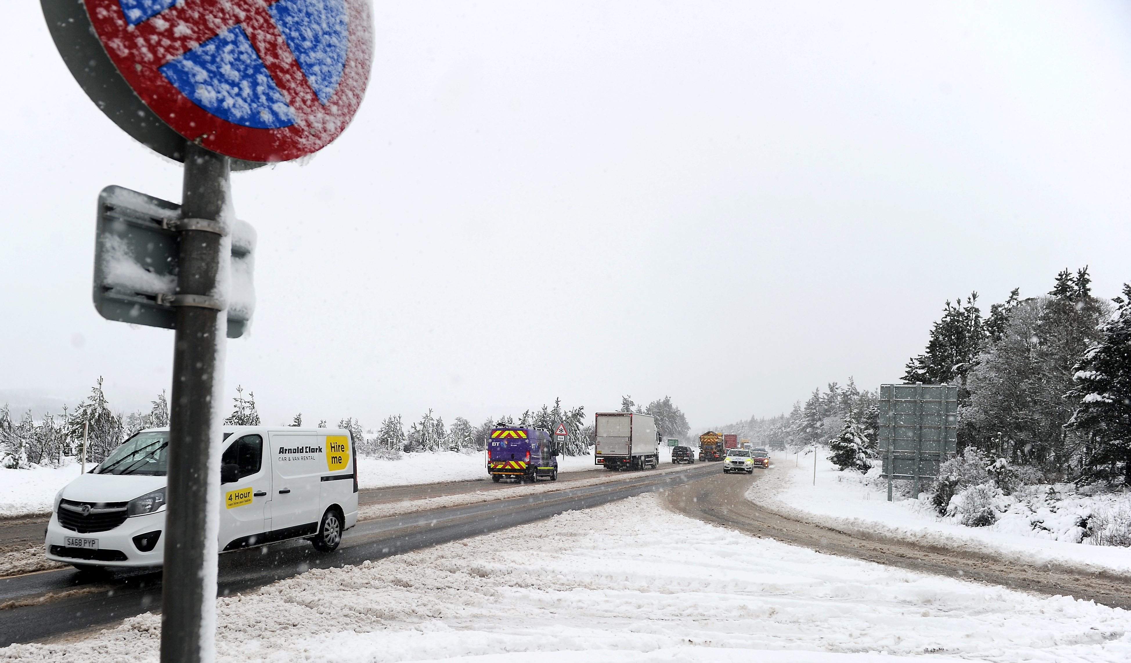 The north was hit the hardest with motorists at Slochd on the A9 delayed yesterday morning in unfavorable driving conditions. Picture by Sandy McCook