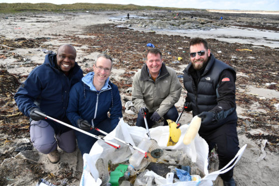 Premier Oil beach clean at Cairnbulg.  L-R: Jacob Opata, Martin O'donnell, Paul Williams and Lee Gilmore