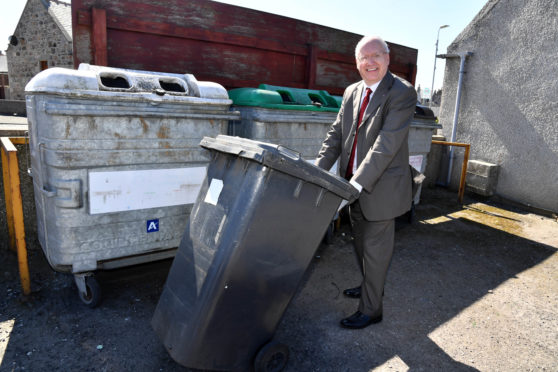 Councillor Glen Reynolds at the Whitehills bottle bank