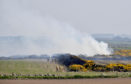 Fire services battle the gorse fire near Peathill.