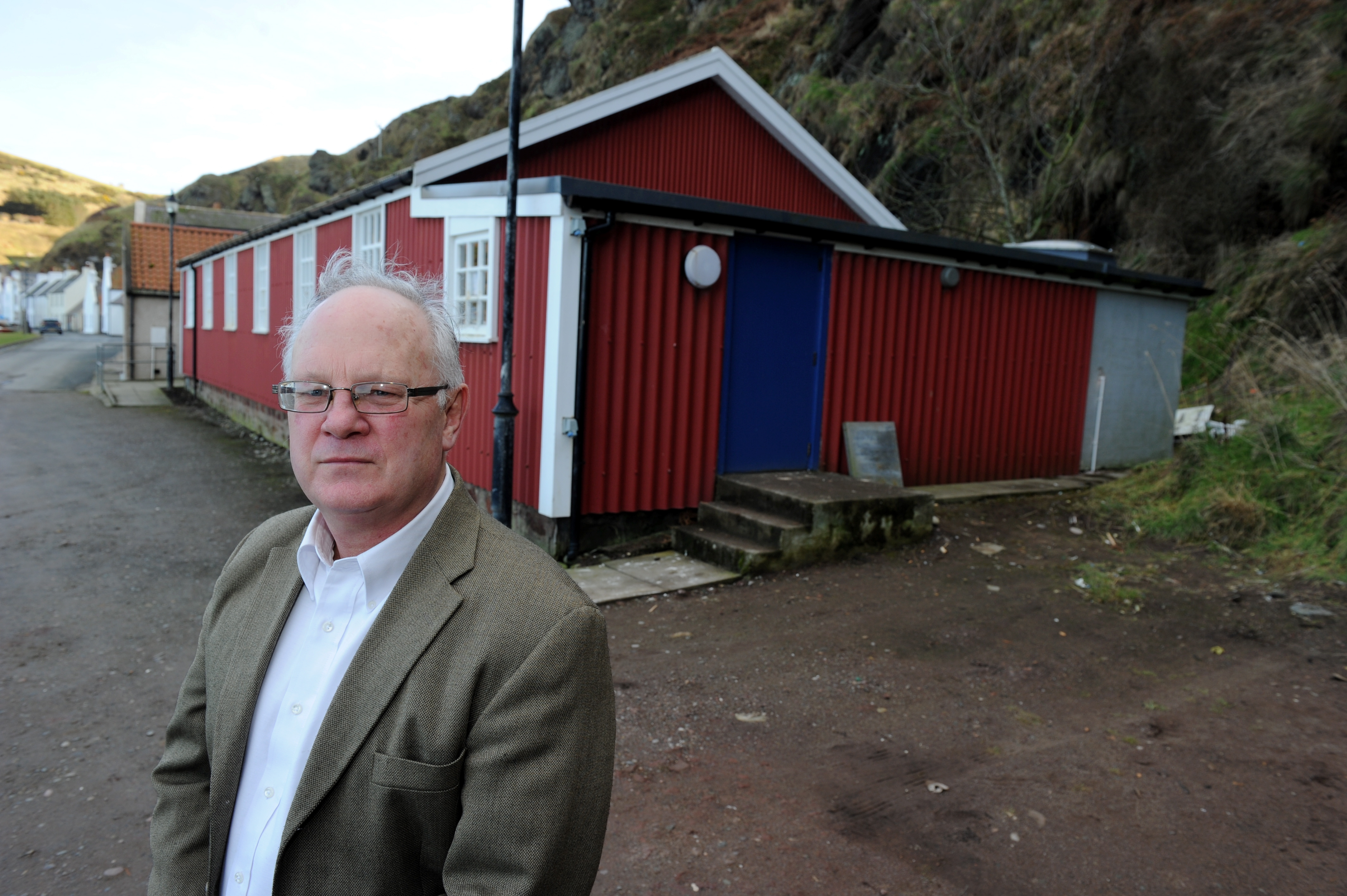 Pennan community council have raised concerns about plans to build a 4G mast next to the village hall. Picture of Pennan Community Councillor Bill Pitt outside the village hall.  Picture by KENNY ELRICK     13/02/2019