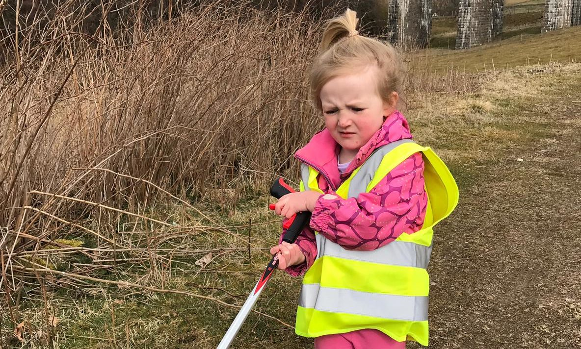 A young litter picker cleaning up at Tomatin.