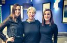 Sandra McKinlay (centre) who celebrated her 25 year milestone this week, pictured with daughters Lianne (left) and Laura (right).
