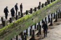 Police search beside one of the groynes at Aberdeen beach