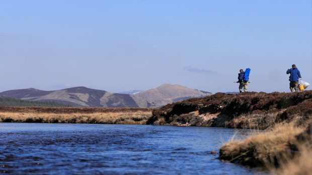 River Dee staff make their way to the project site on the River Muick