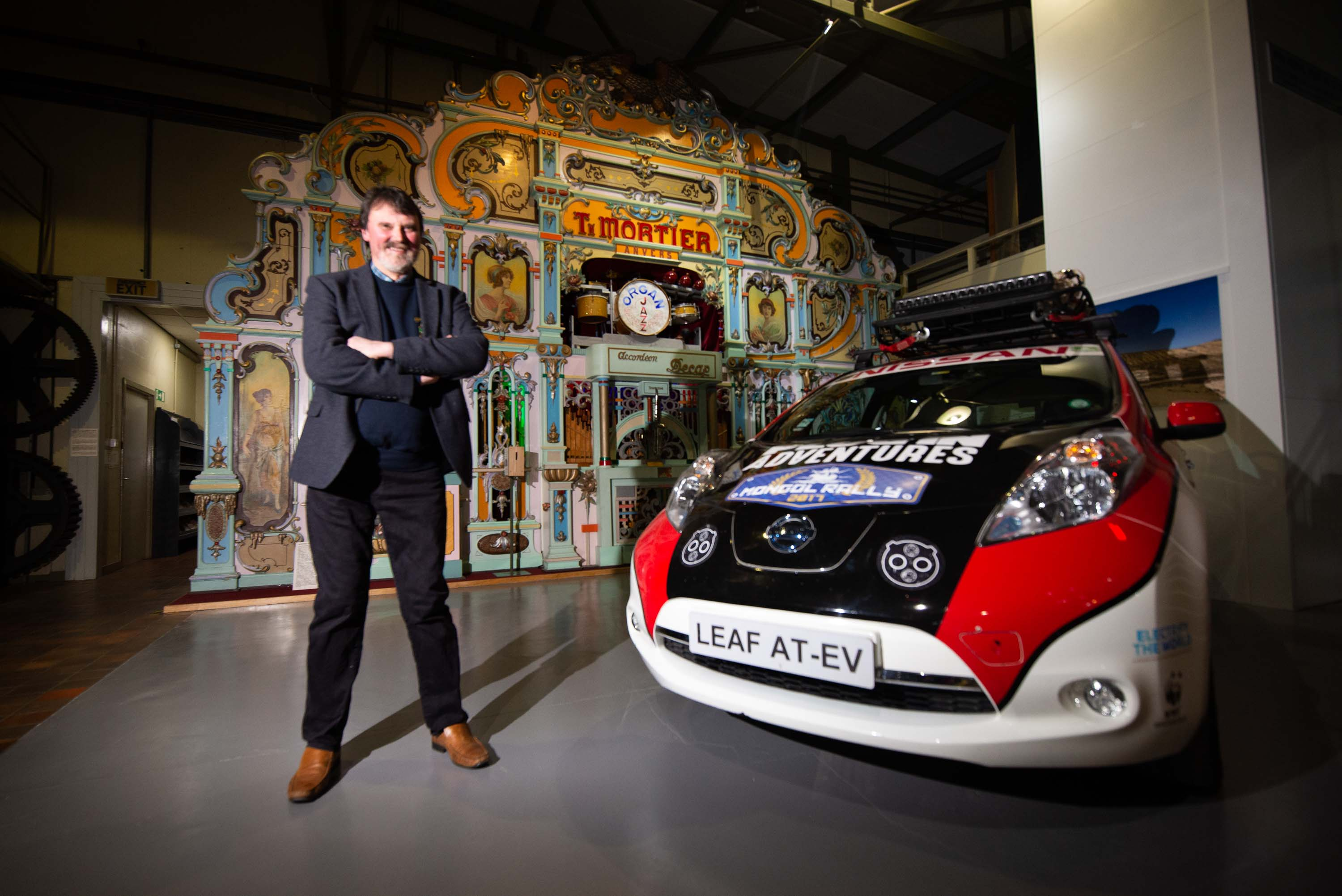 Mike Ward with the new exhibitions. He is pictured with the new Nissan Leaf rally car.