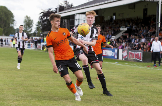 28/07/18 BETFRED CUP GROUP A  ELGIN CITY v DUNDEE UNITED (0-4)   BOROUGH BRIGGS - ELGIN  Dundee United's Matthew Smith (left) holds off Elgin's David Wilson