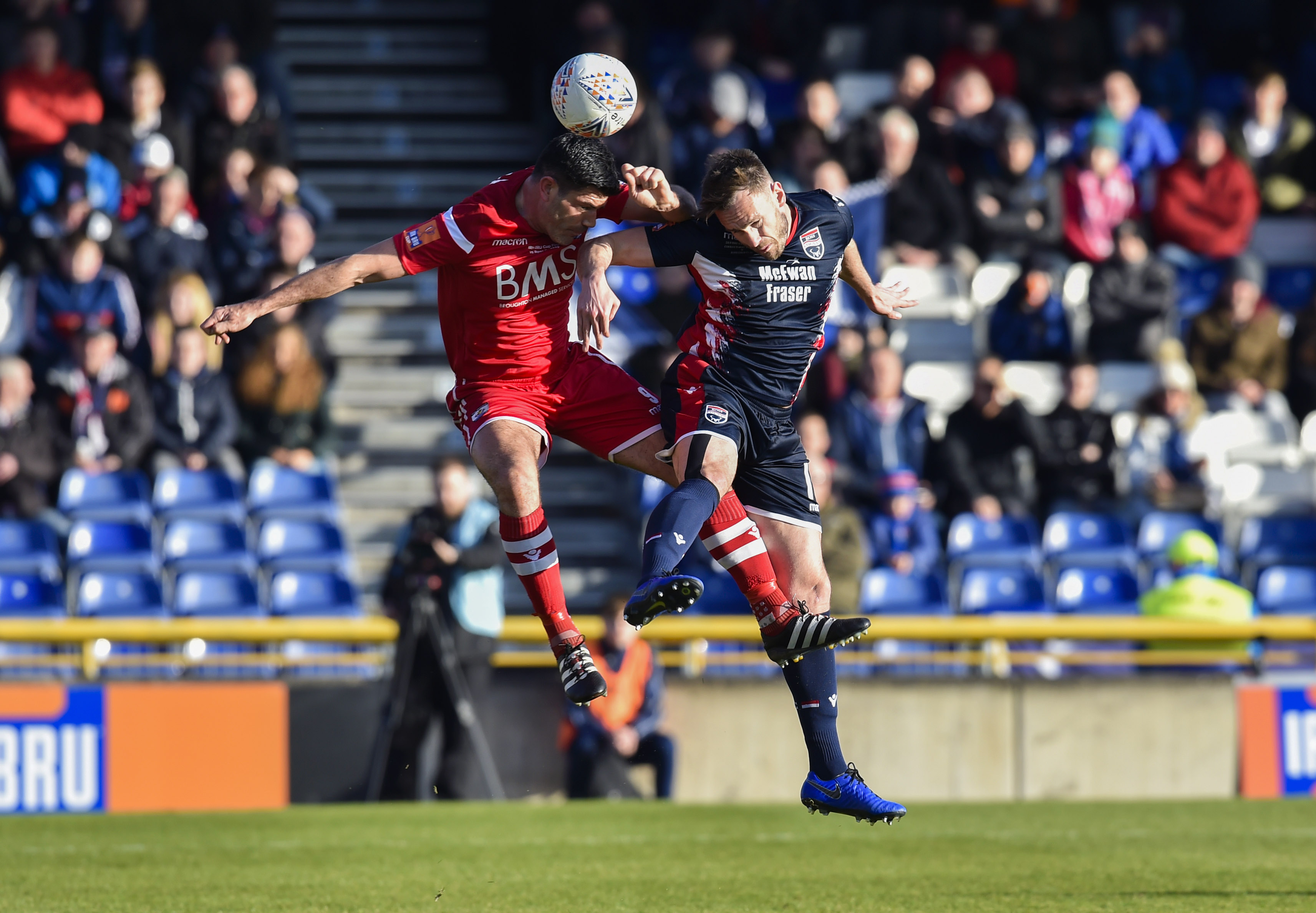 Ross County defender Andy Boyle (right) is on loan from Preston.
