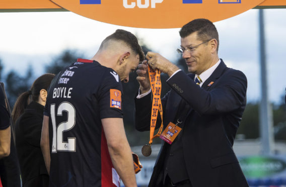 Andy Boyle receives his IRN-BRU Cup medal from SPFL chief executive Neil Doncaster.