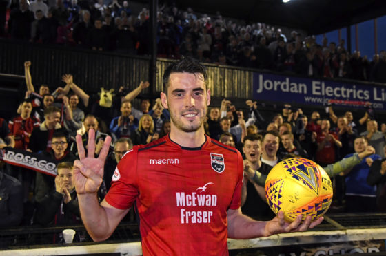 Ross County striker Brian Graham takes home the match ball.