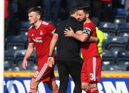 Aberdeen manager Derek McInnes celebrates with captain Graeme Shinnie (R) at full-time.