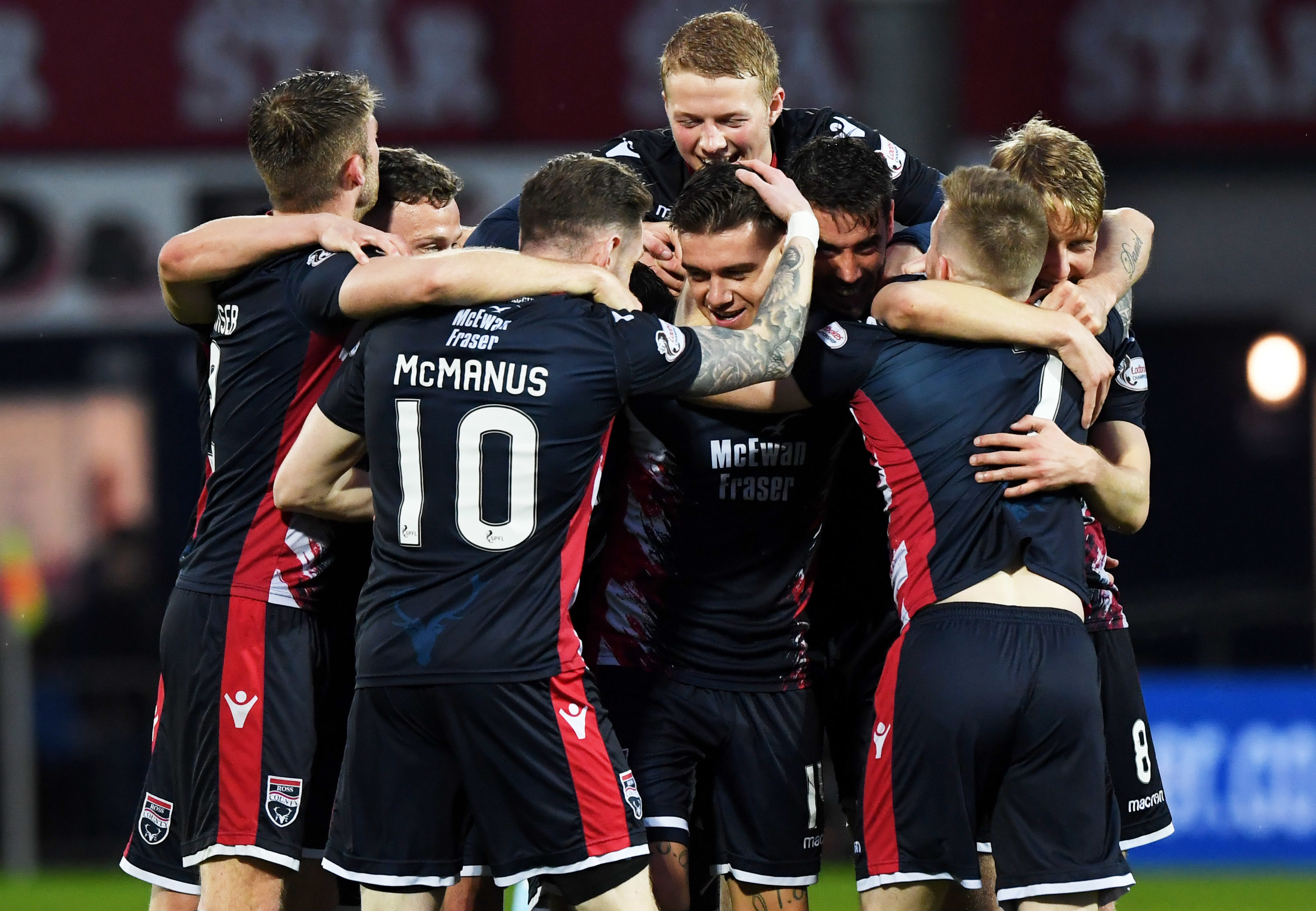 Ross County's Josh Mullin (centre) celebrates his goal to make it 3-0 with his team-mates