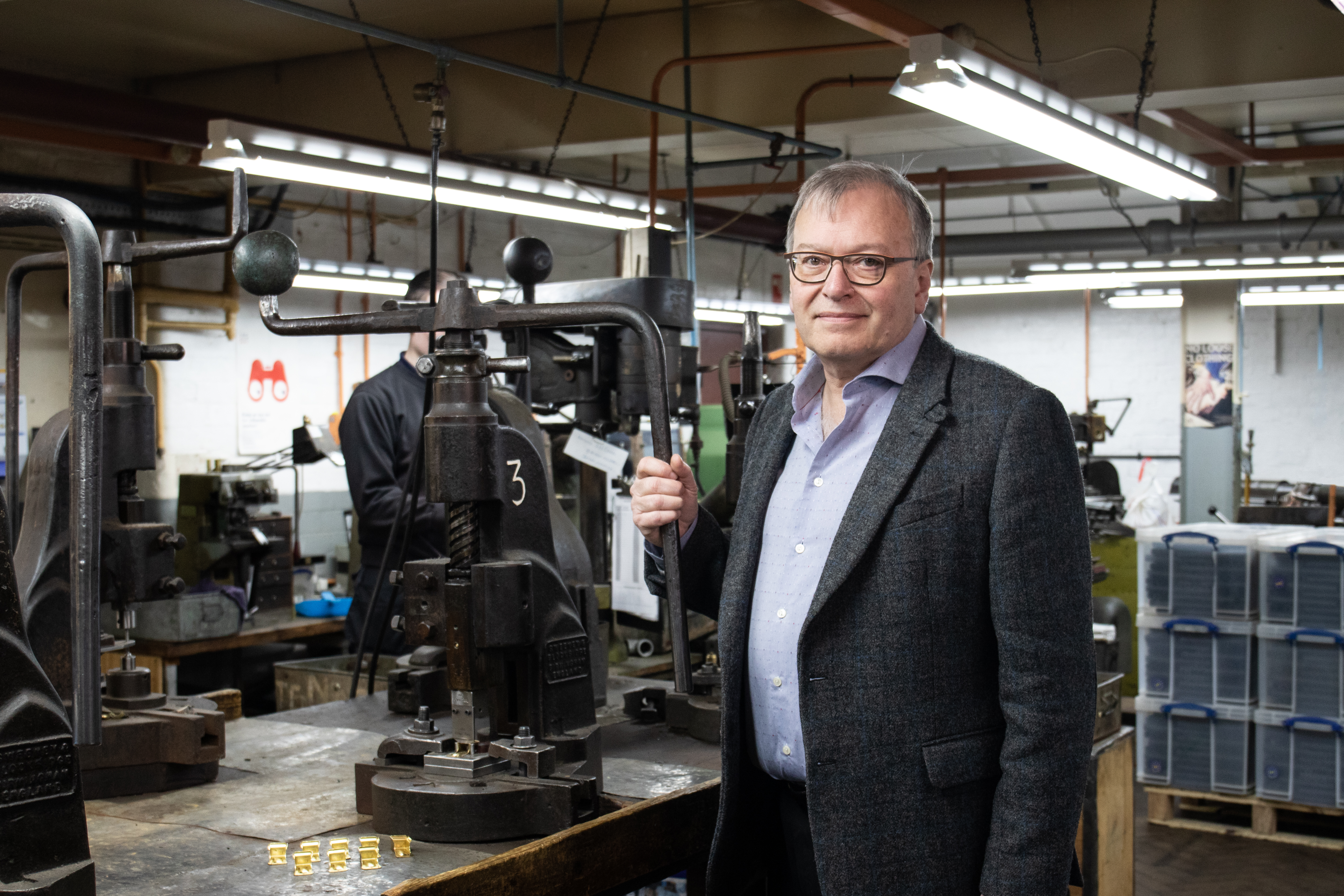 Simon Topman, Managing Director at ACME Whistles, stands next to the flypress used to create the ACME 470 Clicker.