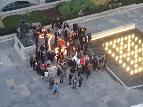 Candles were lit to remember those killed in the attacks