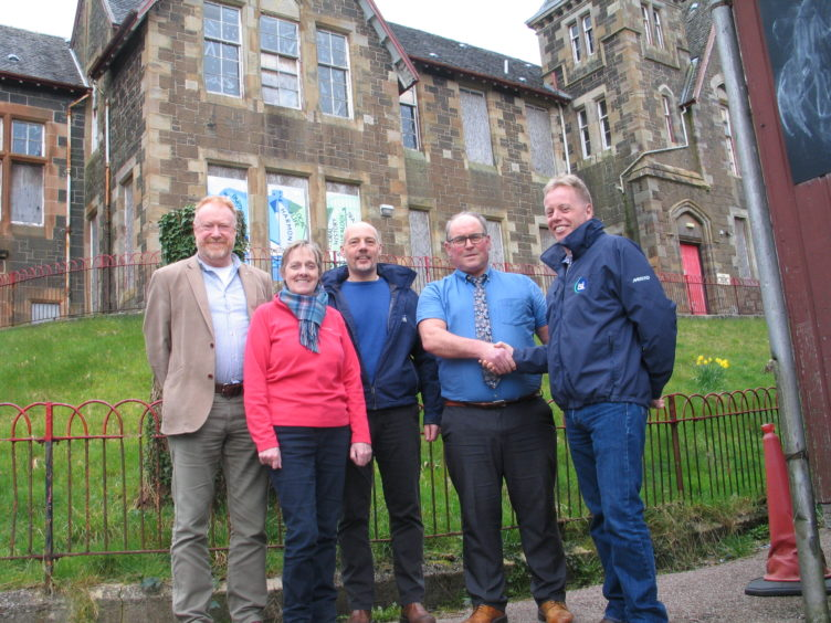 Members of the Oban Communities Trust gathered with representatives of contractors TSL outside The Rockfield Centre before work stated last month.