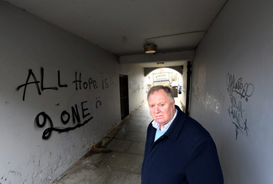 Councillor Bill Cormie at the lane between Richmond Street and Richmond Walk, for which he has received many complaints about the graffiti.      Picture by Kami Thomson.