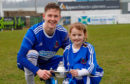 Cove Rangers midfielder Blair Yule with young supporter Megan McIntosh.