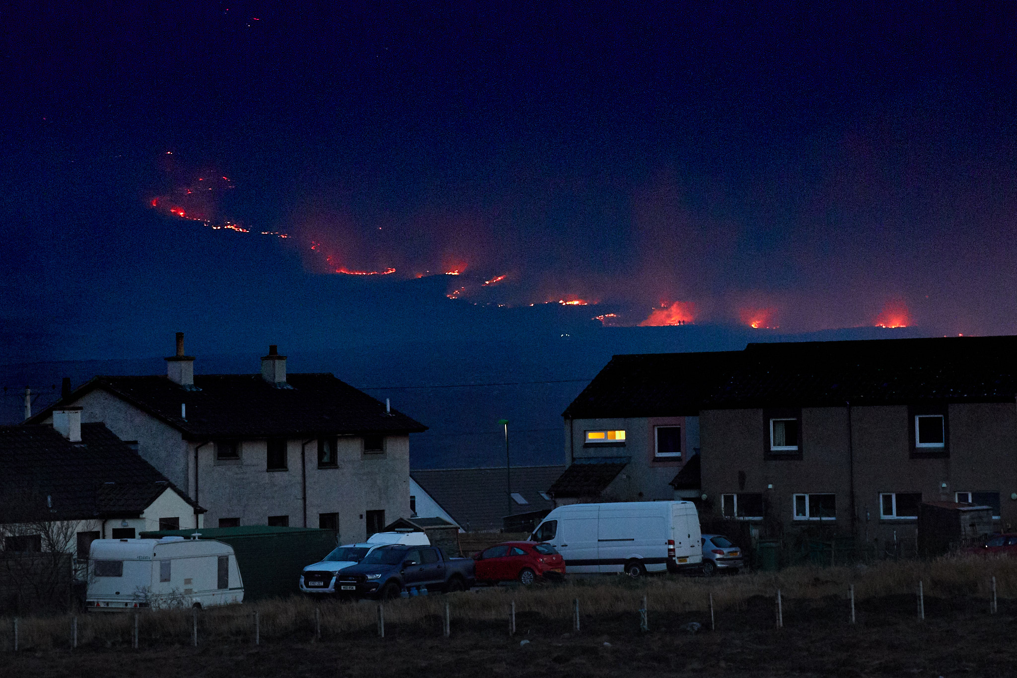 """Firefighters battled for the fourth day the huge blaze in """"tinderbox"""" conditions - only finally leaving at 4.20am this morning."""
