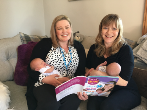 Trainee health visitor Annmarie Smith pictured on the left holding baby Eddie Gray and Michelle Leye (Mum) on the right breastfeeding his brother William Gray