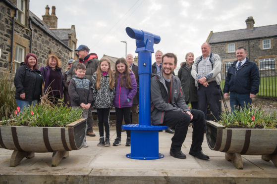 Portsoy community council instal a new telescope at the town's harbour. The community council have paid for the device which offers views of the harbour and the Moray Firth. It was officially opened by Whisky Galore! actor Sean Biggerstaff.  Pictures: Jason Hedges