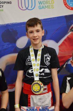 Aidan Lennan on the podium at the WAKO British Championships.