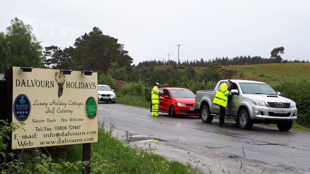 Police question motorists on the B851.