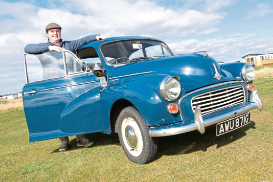Darren Macrae from Embo with his 1969 Morris Minor 1000 in Trafalgar Blue photographed at Dornoch.
