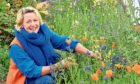 Ailsa van Rooyen with some of her flowers.