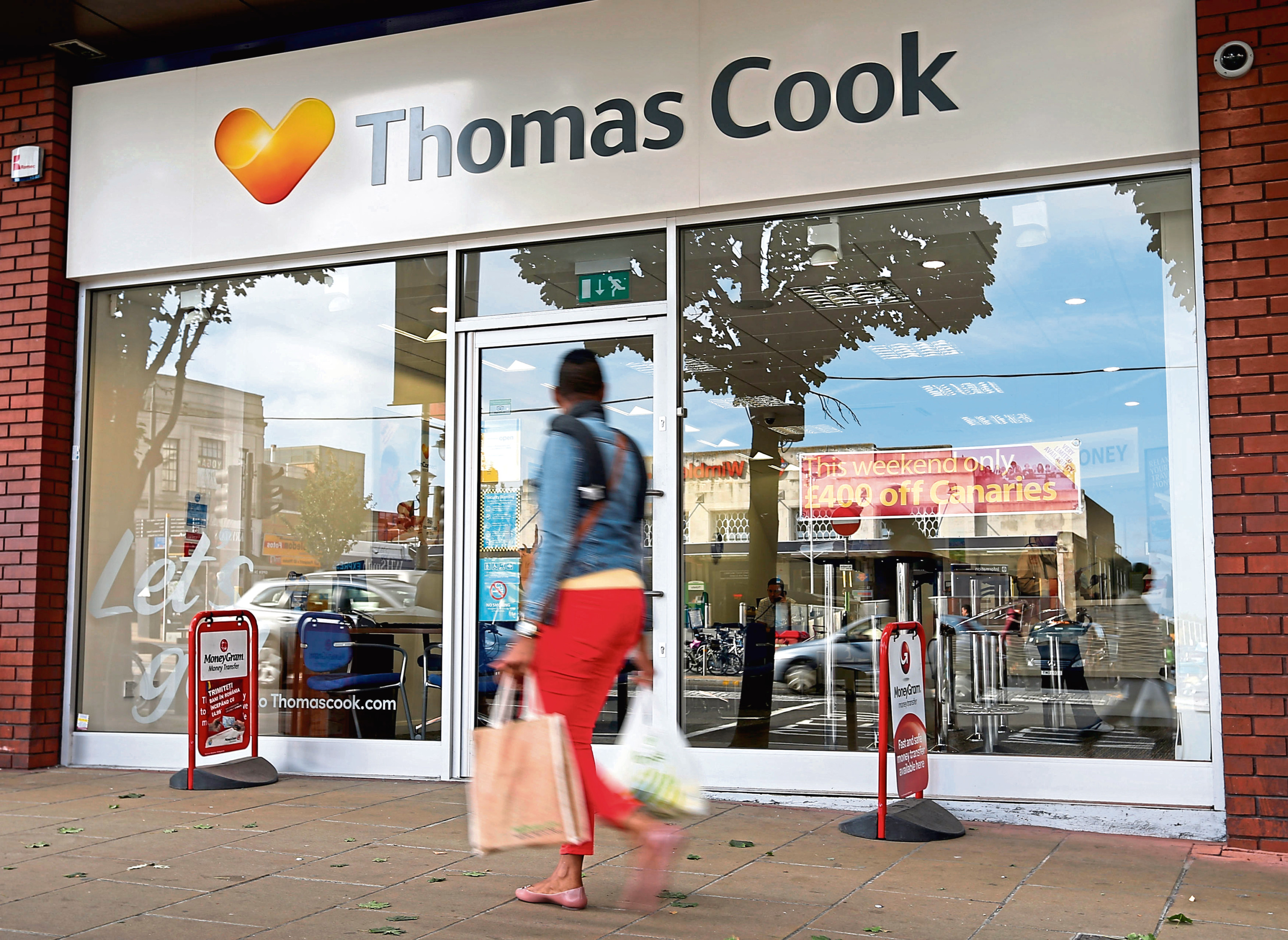 """Thomas Cook File photo dated 07/10/13 of a Thomas Cook travel shop as the boss of the holiday firm said he had never experienced such """"unprecedented"""" disruption in his 30-year career after the deadly terrorist attacks in Tunisia, Egypt and Paris."""