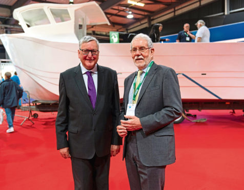 Fisheries Secretary Fergus Ewing (L) and Scottish Fishermen's Federation chief executive Bertie Armstrong (R).