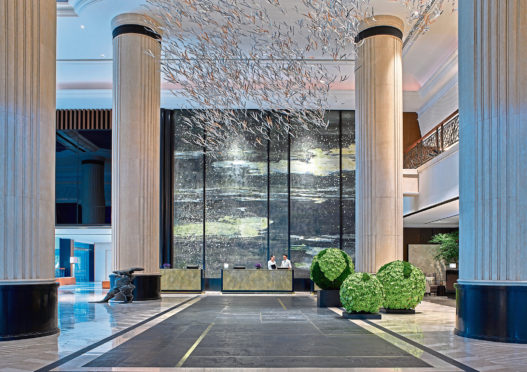 Shangri-la Singapore reception with tree canopy by Japanese designer Hirotoshi Sawada