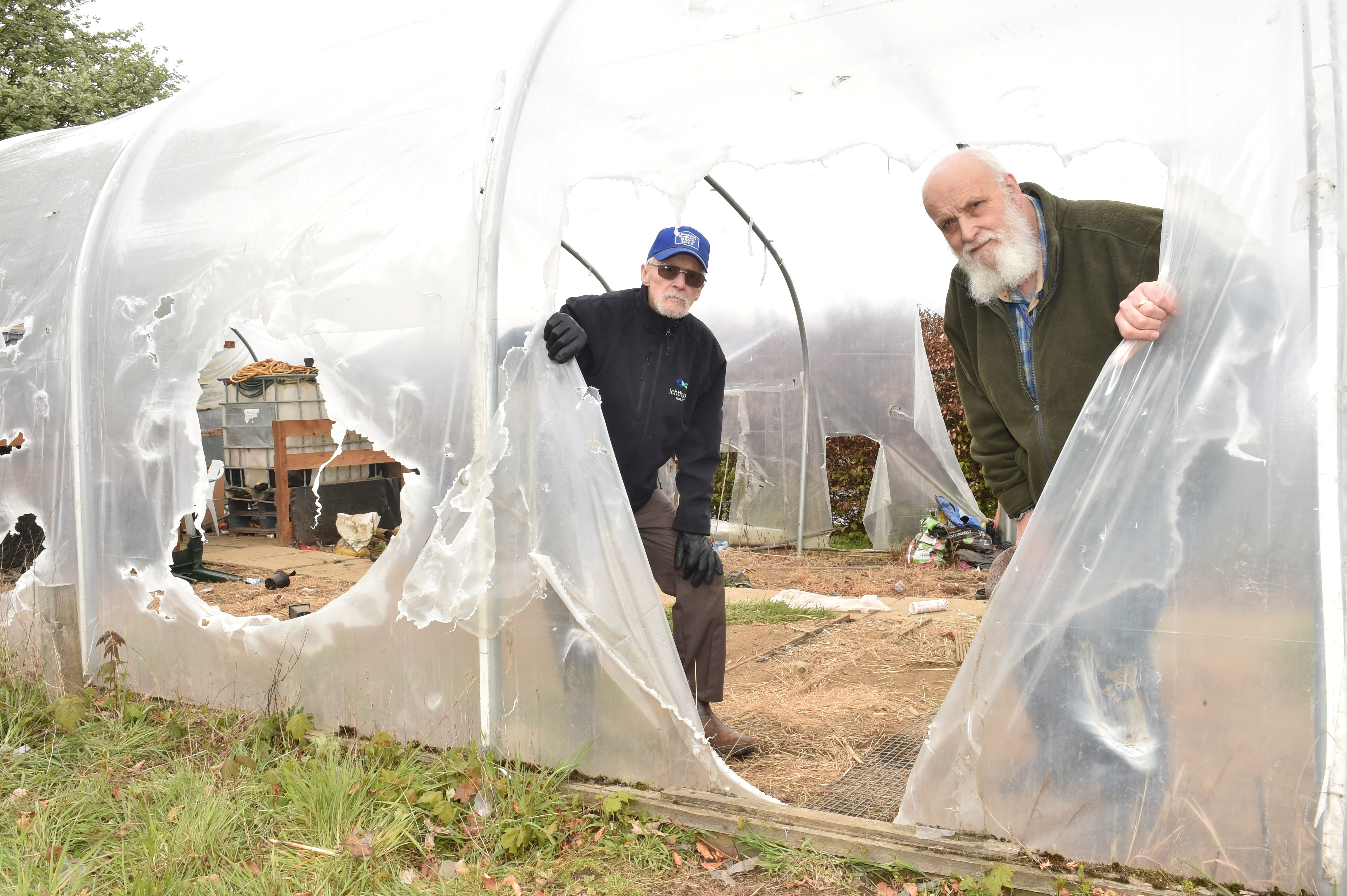 The Inverurie and District men's shed has been vandalised, yet again. - members Leith Robertson and Jim Smith inspect the damage.