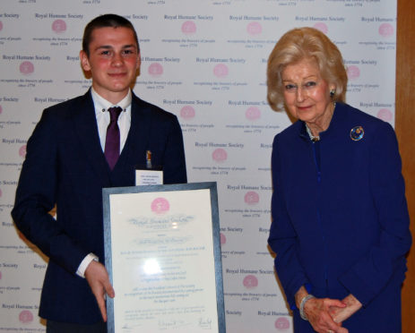 Jordan Anderson being presented with his award by Princess Alexandra.
