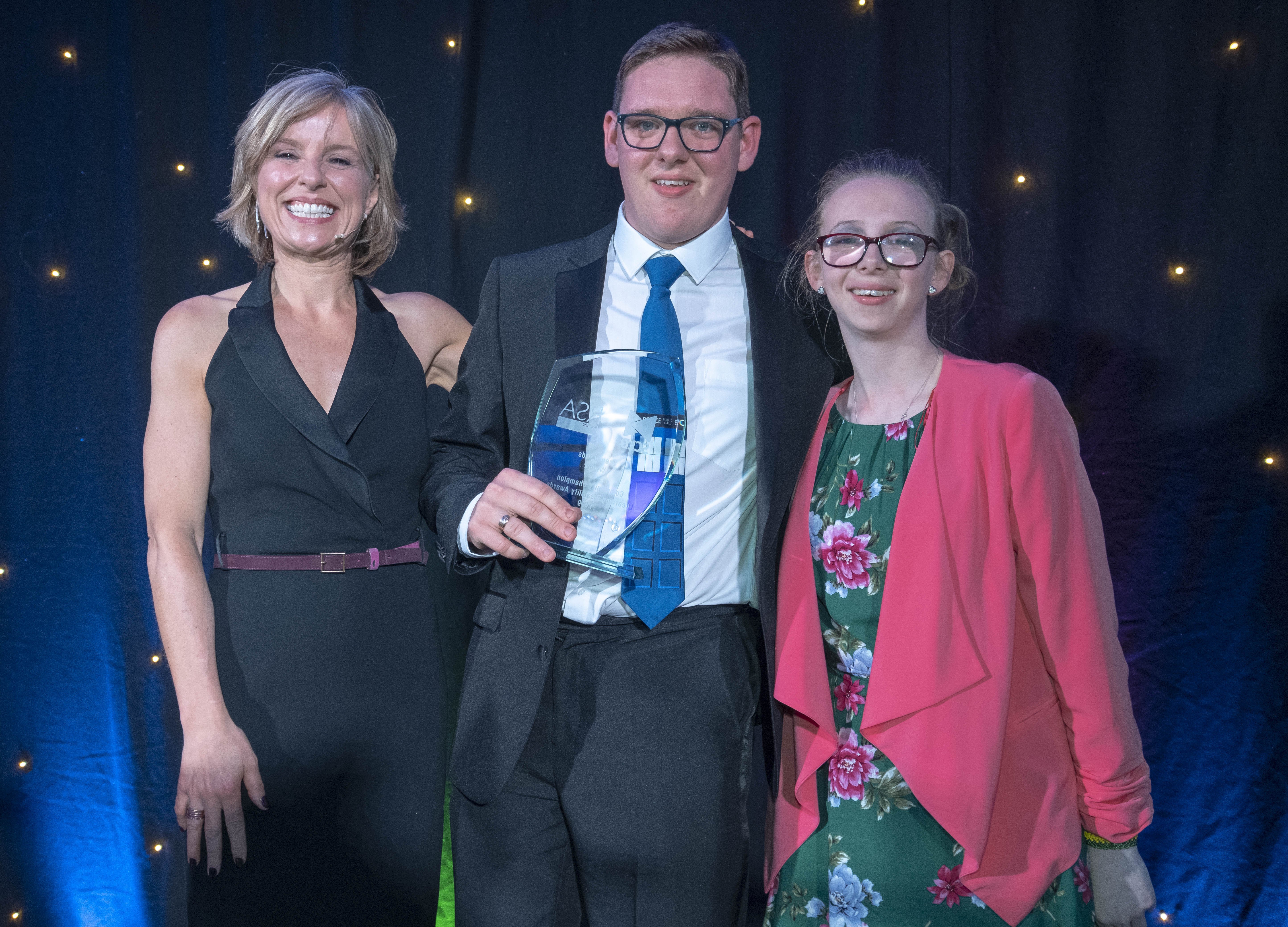 Greg Brands with Rona Dougall, left, the host of the awards, and Leeanne Clark, the award presenter.