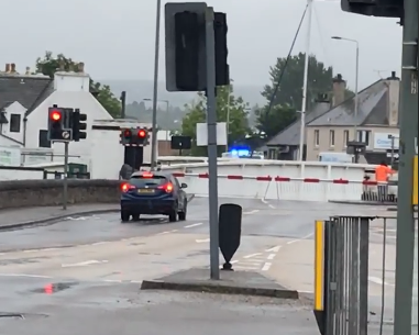 The ambulance, which was on a blue light run at the time, was held up by the Muirtown Swing Bridge after it had opened to let passing water traffic through