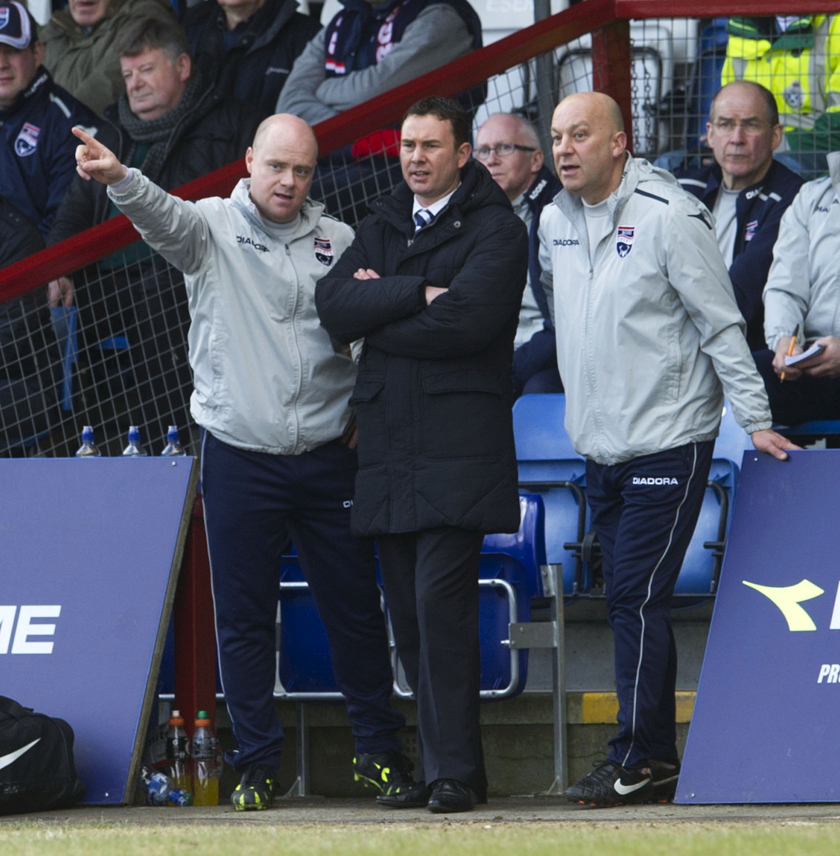 Adams (centre) at County with assistant Neale Cooper (right) and coach Steven Ferguson - who is now Staggies co-boss.