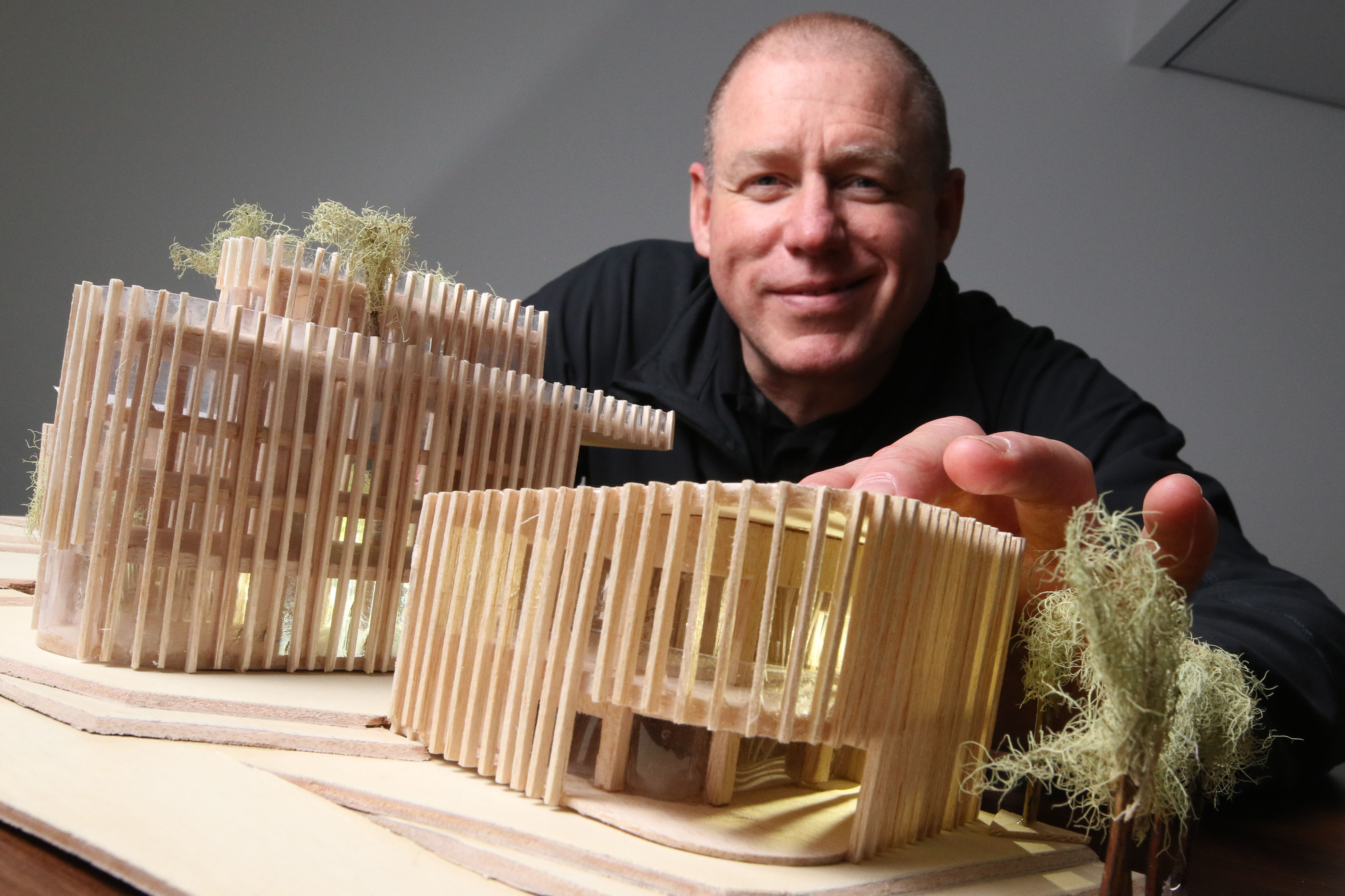 Dez Jones, one of the students, with the model he built of how the site could look.