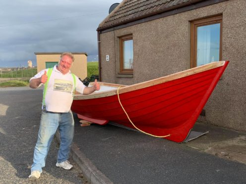 George Cameron with his boat