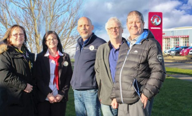 Buckie councillor Sonya Warren, Tesco employees Zoe Dallas and Richard Ross-Boyd, Moray Council's planning committee chairman David Bremner and Buckie councillor Gordon Cowie stand where the gateway installation will be put up.