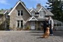 Moira Milne has run Glendavan House for 40 years and is now run by daughter Rebecca, They are pictured with their dog Lex. Picture by Colin Rennie.