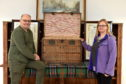 Clive Hampshire and Angela Allan from Smile Scotland with the vintage steamer trunk.