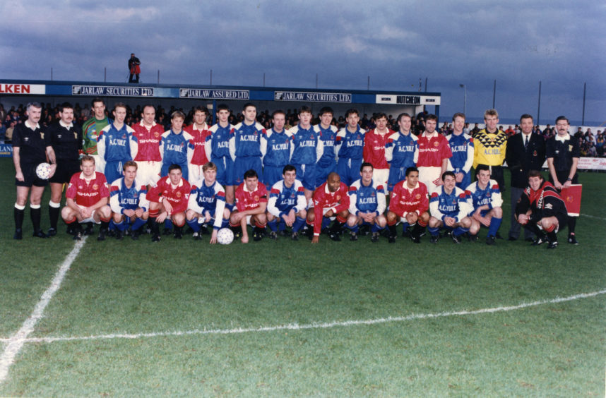 The Cove Rangers and Manchester United players and officials line-up before the show game at Allan Park. Picture taken 15 November 1992.