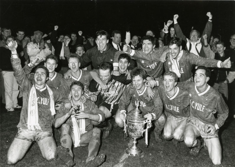 The Cove Rangers players celebrate after their Qualifying Cup triumph against Fraserburgh at Huntly in 1990.