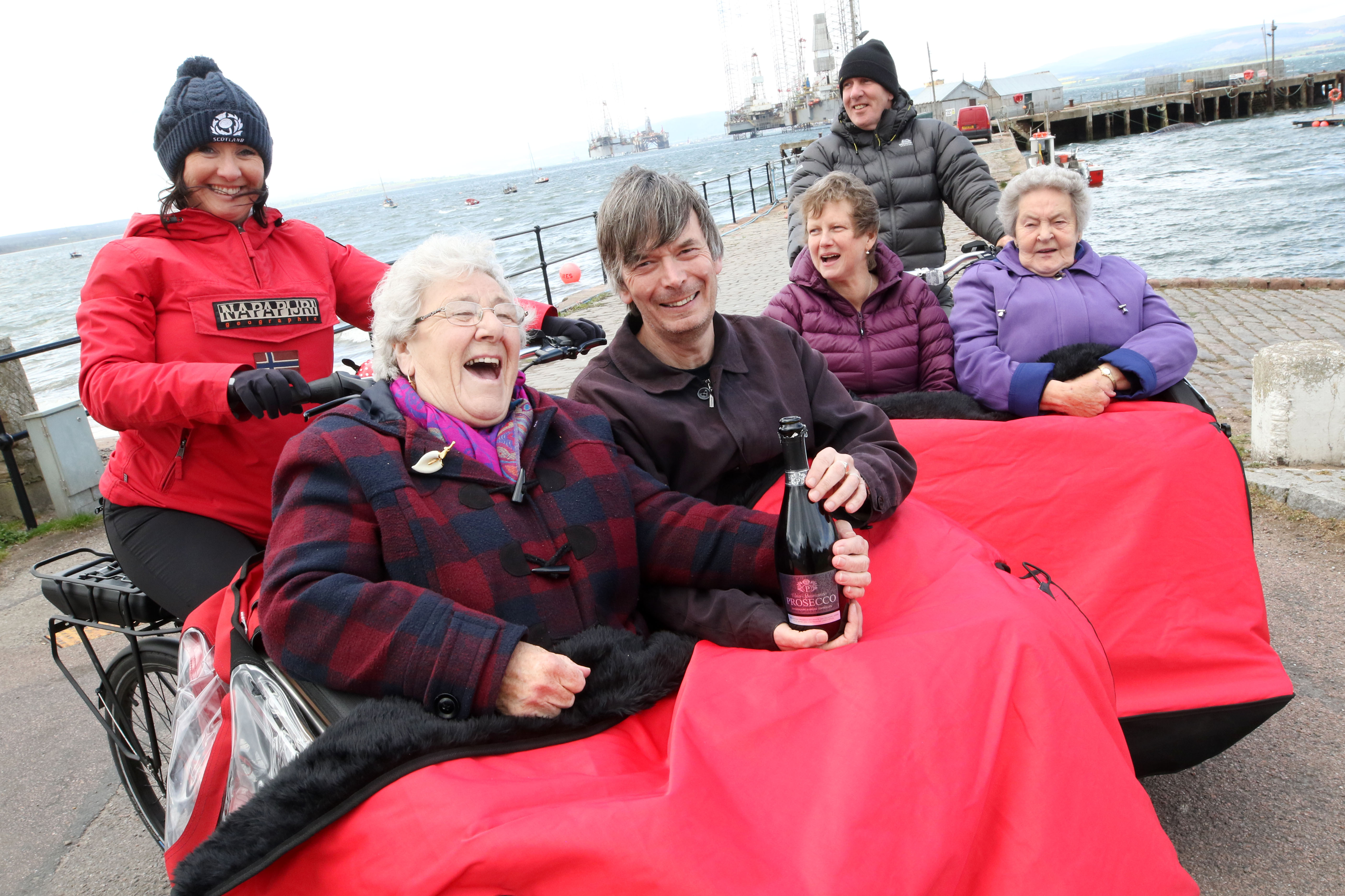 Ian Rankin joined Jean Young, Fiona Grist, Cromarty Care Project trustee Shirley Matheson, June Shepard and Ian Mitchell as two trishaws were delivered to Cromarty